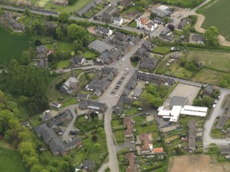 Oblique aerial view centred on the village centre, taken from the N.