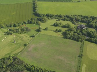 General oblique aerial view centred on the house with the policies adjacent, taken from the N.