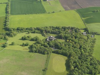 General oblique aerial view centred on the house with the policies adjacent, taken from the NNW.