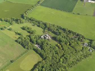 General oblique aerial view centred on the house with the policies adjacent, taken from the NW.