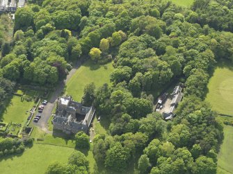 Oblique aerial view centred on the house with the terraced garden adjacent, taken from the ENE.