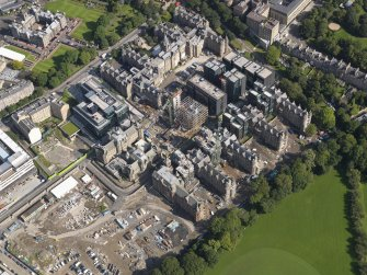 Oblique aerial view centred on the Quartermile development and the former Edinburgh Royal Infirmary, taken from the SW.