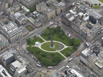 Oblique aerial view centred on St Andrew Square, Edinburgh taken from the NW.