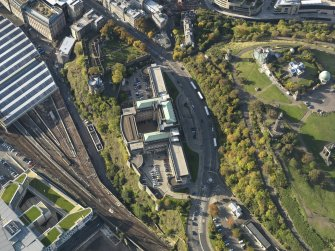 Oblique aerial view centred on the St Andrew's House with Calton Hill adjacent, taken from the SE.