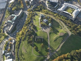 Oblique aerial view centred on Calton Hill with St Andrew's House adjacent, taken from the E.