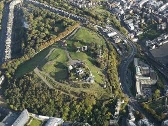 Oblique aerial view centred on the Calton Hill with St Andrew's House adjacent, taken from the