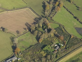 General oblique aerial view centred on the church with the churchyard adjacent, taken from the SSW.