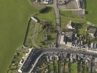 Oblique aerial view centred on the church (s) with the graveyard adjacent, taken from the E.