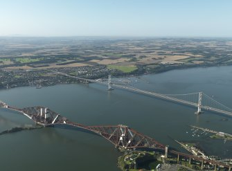 Oblique aerial view centred on the Forth Bridge with the Forth Road Bridge adjacent, taken from the NE.