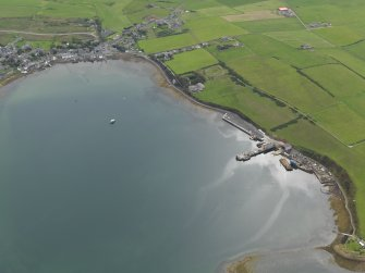 General oblique aerial view centred on the new ferry terminal with the village adjacent, taken from the NNE.