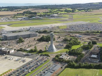 Oblique aerial view of the airport centred on the air traffic control tower, taken from the SSE.