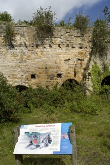 Limekilns, view from S with information board in foreground