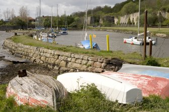 Harbour and limekilns, view from E with upturned boats in foreground