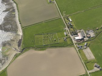 Oblique aerial view centred on St Nicholas' Church, Orphir with Bu of Orphir farmstead adjacent, taken from the ENE.