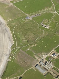 General oblique aerial view centred on Skara Brae with Skaill House and farm adjacent, taken from the W.