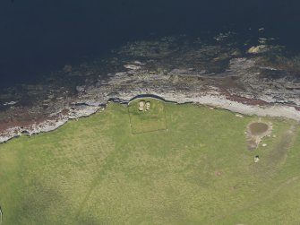 Oblique aerial view centred on the Knap of Howar neolithic settlement, taken from the ESE.