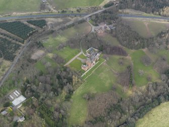 Oblique aerial view of Ayton Castle and policies, taken from the SSW.