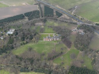 Oblique aerial view of Ayton Castle and policies, taken from the SE.