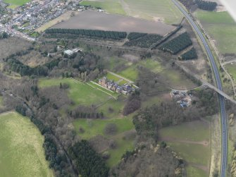 Oblique aerial view of Ayton Castle and policies, taken from the ESE.