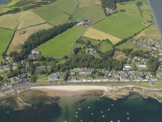 General oblique aerial view of Millport centred on the Cathedral of the Isles, taken from the S.