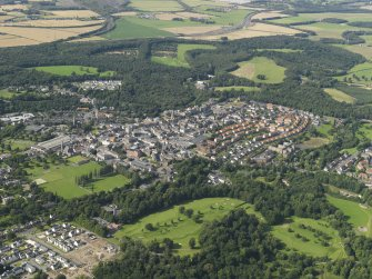 General oblique aerial view of Dalkeith with Dalkeith House and country park beyond.