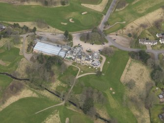 Oblique aerial view centred on the country house (hotel),  taken from the SW.