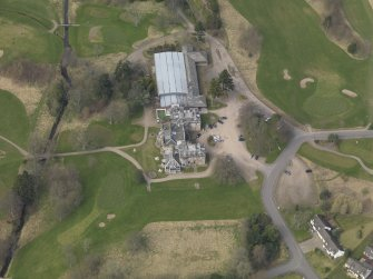 Oblique aerial view centred on the country house (hotel),  taken from the SE.