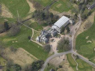 Oblique aerial view centred on the country house (hotel),  taken from the E.