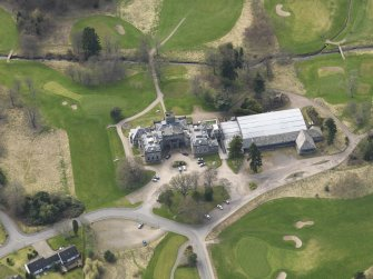Oblique aerial view centred on the country house (hotel),  taken from the NE.