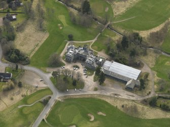 Oblique aerial view centred on the country house (hotel),  taken from the N.