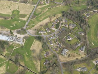 Oblique aerial view centred on the stables with the country house (hotel) adjacent,  taken from the SSW.