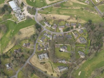 Oblique aerial view centred on the stables with the country house (hotel) adjacent,  taken from the SSE.