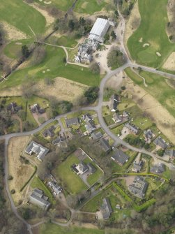 Oblique aerial view centred on the stables with the country house (hotel) adjacent,  taken from the  SE.