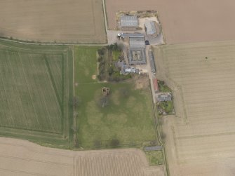 General oblique aerial view centred on the remains of the tower-house with the farmstead adjacent, taken from the SSE.