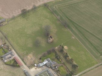General oblique aerial view centred on the remains of the tower-house, taken from the NE.