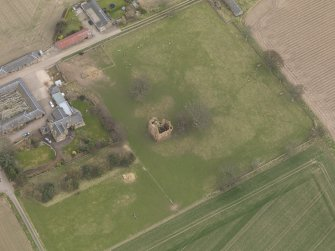 Oblique aerial view centred on the remains of the tower-house, taken from the WNW.