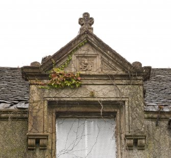 Detail of dormer with carved thistle motif in the pediment and finial on  on E side of front elevation.