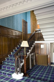 Interior view of entrance hall and staircase at Annick Lodge, Irvine.