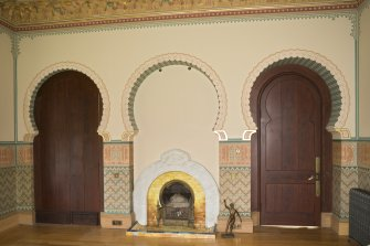 Interior. 1st floor, drawing room, view of fireplace flanked by doors