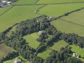 Oblique aerial view centred on the house, taken from the NE.