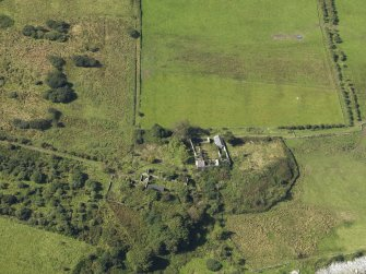 Oblique aerial view centred on the farmsteads and the site of the chapel, taken from the E.