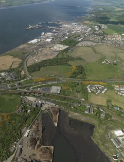 General oblique aerial view looking over Ward's shpbreaking yard towards HM Dockyard Rosyth, taken from the E.
