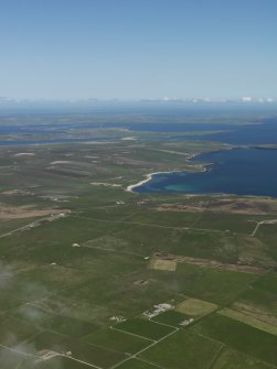 General oblique aerial view of South Ronaldsay looking across Ward Hill and Newark Bay with Burray beyond, taken from the S.
