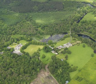 General oblique aerial view of Kinmount House and policies, taken from the SW.
