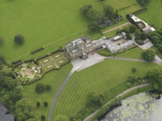 Oblique aerial view of Kinmount House and rose garden, taken from the NNE.