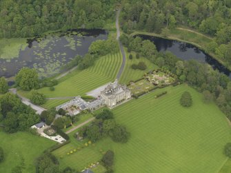 Oblique aerial view of Kinmount House and rose garden, taken from the SW.
