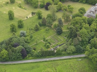 Oblique aerial view of Sorn Castle garden, taken from the S.