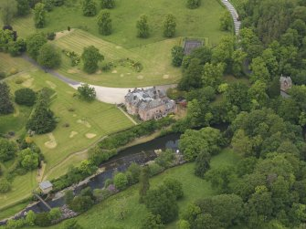 Oblique aerial view of Sorn Castle and turbine house, taken from the SSW.