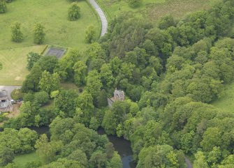 Oblique aerial view of Cleuch Cottage at Sorn Castle, taken from the SSE.