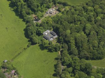 Oblique aerial view of Montgreenan Mains farmhouse, taken from the WSW.